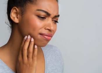 Struggling With Stiff Jaw Movement? TMJ Treatment Can Help